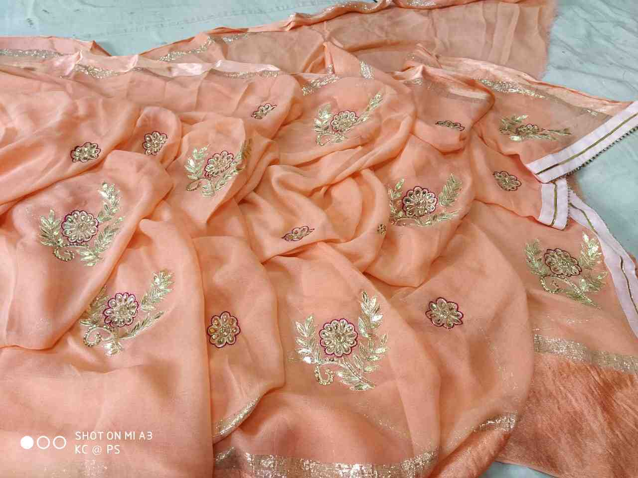 beautiful georgette satan saree of kundan work